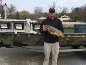 Brandon Smith with his $1,000 tagged carp